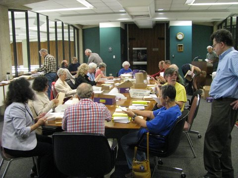 Volunteers preparing a mailing announcing  upcoming 'Patients Not Profits' demonstration