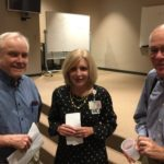 Charlie Casper, Dr. Barbara Casper, and Dr. Garrett Adams at the Grand Rounds.