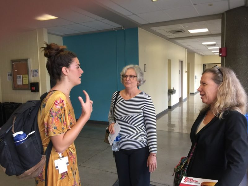 Drs. Carol Paris and Margaret Flowers speak with a medical student after the program.