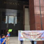 Christine Perlin speaking at the demonstration at Humana.