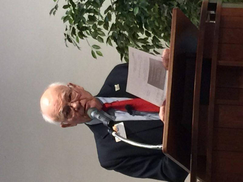 Dr. Garrett Adams speaking at the Unitarian Church
