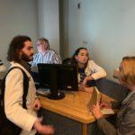 Medical students Erik Seroogy and Sarah Parker speak with Courier Journal reporter Deborah Yetter