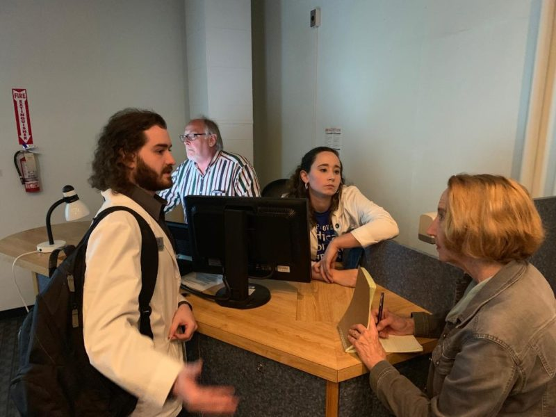 Medical students Erik Seroogy and Sarah Parker speak with Courier Journal reporter Deborah Yetter