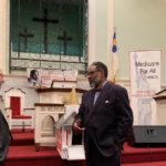 Professor Gerald Friedman, the Rev. Ron Robinson, Dr. Garrett Adams