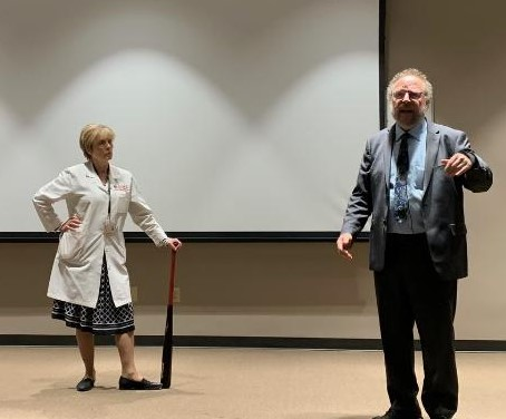 Friedman was given a Louisville slugger bat to honor his Louisville presentation.