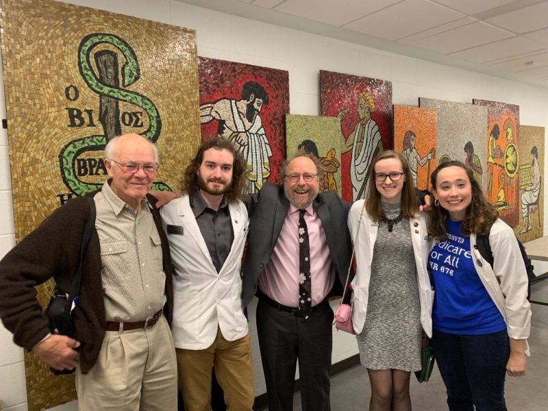 L to R:  Garrett Adams, MD, Erik Seroogy, Professor Gerald Friedman, Dana Oakes, Sarah Parker in front of mosaics at the UofL Medical School