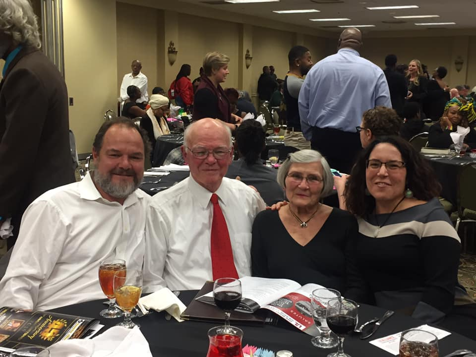 Dr. Garrett Adams at the Unity Dinner with his wife Lane, son Burt, and daughter Carrie Irwin.